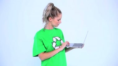 Troubled environmental activist using a laptop — Stock Video