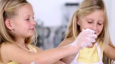 Twin sisters making dough for cake — Stock Video
