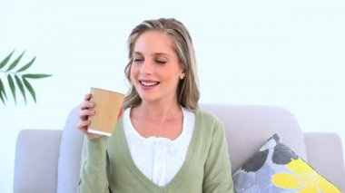 Cheerful woman drinking coffee — Stock Video