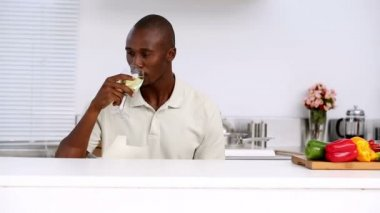 Man in kitchen drinking wine — Stock Video