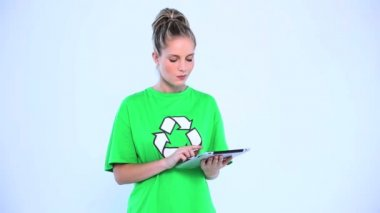 Doubtful environmental activist using a digital tablet — Stock Video