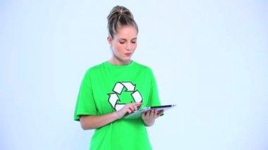 Doubtful environmental activist using a digital tablet — Stock Video