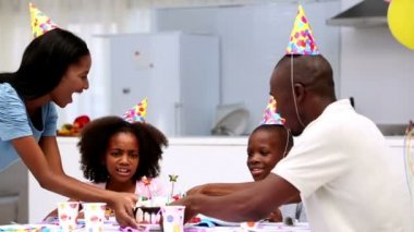 Son blowing out the candles on birthday cake — Stock Video