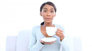 Pretty woman drinking a coffee — Stock Video