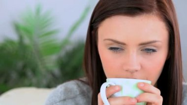 Brunette woman holding a cup of coffee — Stock Video