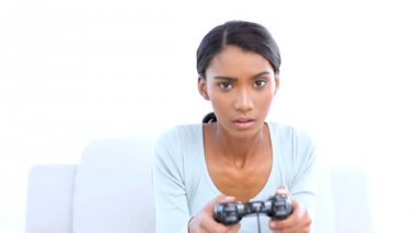 Woman playing and losing at video games — Stock Video