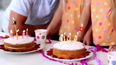 Family blowing out candles at a birthday party — Stock Video