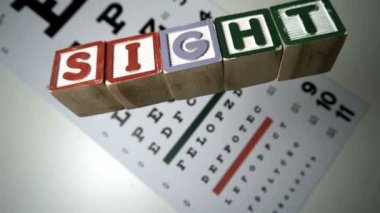 Blocks spelling sight falling on eye test — Vídeo Stock