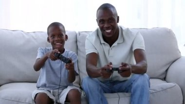 Father and his son playing video games — Stock Video