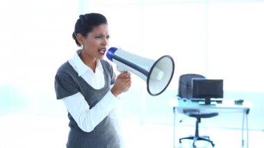 Outraged businesswoman screaming in a megaphone — Stock Video