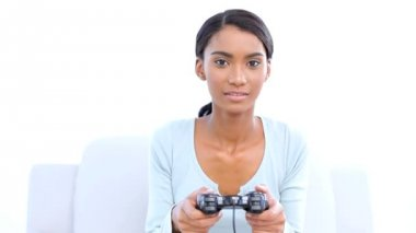Woman playing and winning at video games — Stock Video