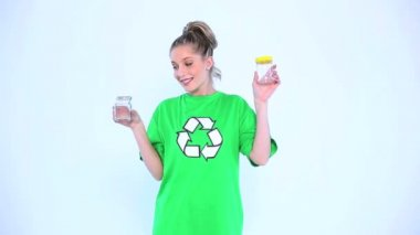 Attractive environmental activist holding two bottles — Stock Video