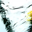 Stock Video: Yellow ink swirling into water whirlpool on white background