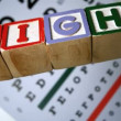Blocks spelling out sight falling on eye test — Vidéo