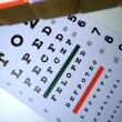 Colorful blocks spelling out sight falling on eye test — Vídeo Stock