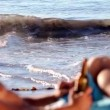 Relaxed mon beach — Vídeo de stock #31531789