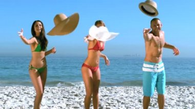 Attractive friends throwing their hat at the same time — Stock Video