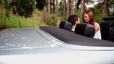 Romantic couple kissing in a car — Stock Video