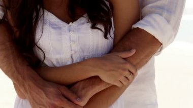 Young couple embracing together — Vídeo de stock
