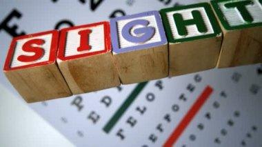 Blocks spelling out sight falling on eye test — Stock Video