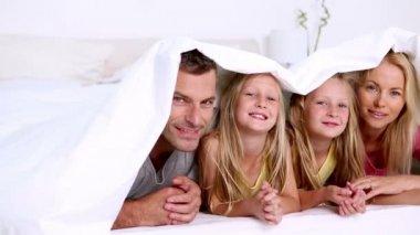 Family under a duvet — Stock Video