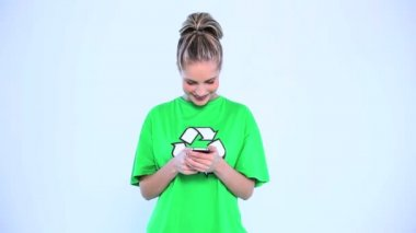 Attractive woman wearing a green t-shirt with recycling symbol on it — Stock Video