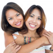 Two pretty sisters posing in front of camera — Stock Photo #33435501