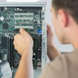 Computer engineer repairing open computer — Stock Photo