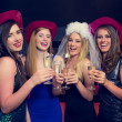 Laughing friends clinking champagne glasses at a hen night — Stock Photo #33435581
