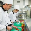 Two young chefs cutting vegetables — Stockfoto #33435649