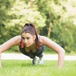 Serious fit woman doing plank position — Stock Photo