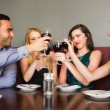 Happy friends drinking red wine in a bar — Stockfoto