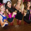 Happy gorgeous women holding flutes of champagne having hen party — Stock Photo