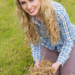 Pretty blonde feeling yellow straw — Stockfoto