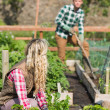 Young couple gardening together — Stock Photo