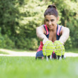 Pretty sporty woman stretching — Stock Photo