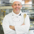 Mature head chef smiling at camera — Stock Photo #33437337