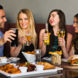 Friends having dinner together and toasting — Foto de Stock