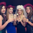 Attractive friends clinking champagne glasses at hen night — Stock Photo
