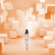 Rear view of businesswoman standing in room with orange blocks — Stock Photo