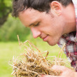 Stock Photo: Young msmelling yellow straw