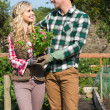 Happy couple standing in the garden — Stock Photo