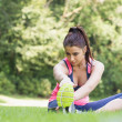 Pretty fit woman stretching  — Stock Photo