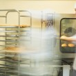 Two bakers working in the kitchen — Stock Photo