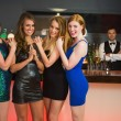 Sexy friends posing in front of barkeeper — Стоковое фото