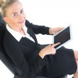Cheerful young businesswoman sitting on an office chair — Stock Photo