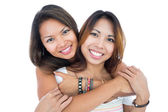 Two pretty sisters posing in front of the camera — Stock Photo