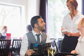 Handsome businessman ordering food from waitress — Stock Photo