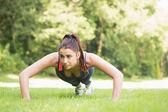 Serious fit woman doing plank position — Foto de Stock