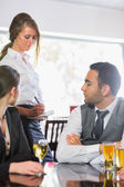 Business people ordering a dinner from waitress — Stock Photo